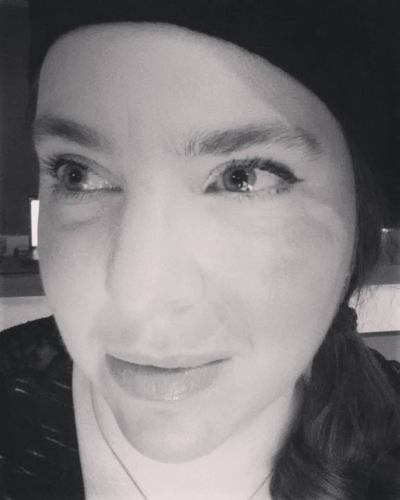 This is the face of an author plotting mischief against her characters. (It's also the face of a person using Instagram filters to hide her lingering disfigurations from last month's tumble.)